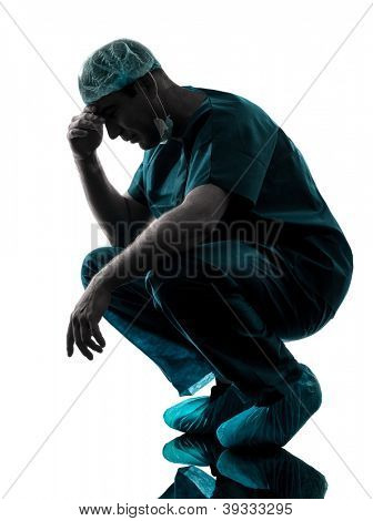one caucasian man doctor surgeon medical worker despair fatigue tired  silhouette isolated on white background