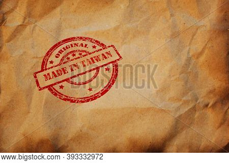 Made In Taiwan Stamp Printed On Crumpled Sheet Of Burnt Paper. Taiwanese Product, Parcel, Package, P