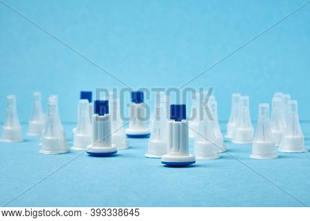 Lots Of Insulin Needles On A Blue Background, Spare Lancet Needles And Syringe Insulin Injection Pen