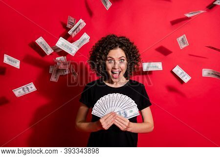 Photo Of Curly Hairstyle Lady Hands Hold Salary Cashback Currency Open Mouth Wealthy Isolated On Red