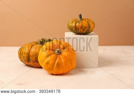 Different Types Of Minin Pumpkins On The Geometrical Podium.organic Concept.can Be Used As Mockup Wi