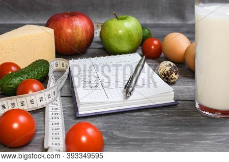 Diet Plan. Notebook With Notes About Diet. Fat. Fresh Vegetables, Fruits, Yoghurt And Measuring Tape
