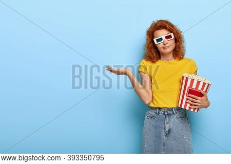 Beautiful Redhead Woman Wears Virtual Glasses, Yellow T Shirt And Denim Skirt, Holds Basket Of Popco