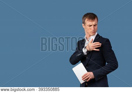 An Arrogant Male Businessman In A Suit Shakes The Dust Off His Clothes And Shoulder With Contempt. S