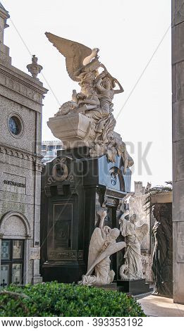 Buenos Aires, Argentiana- December 19, 2008: La Recoleta Cemetery. Elaborate Tall Statue In White St