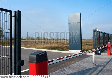 Closed Automatic Gate Of The Barrier. Automatic Security System For Private Areas. Automatic Entry S