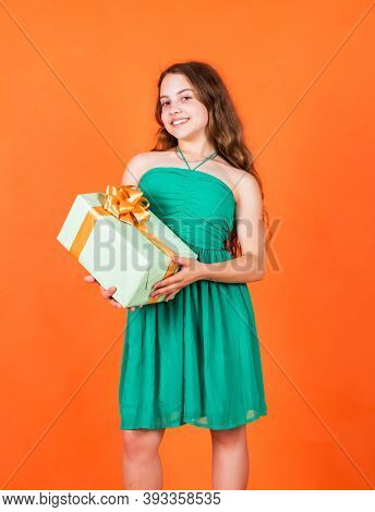 Smiling Little Girl With Shopping Gift. Black Friday Sale. Holidays Concept. International Childrens