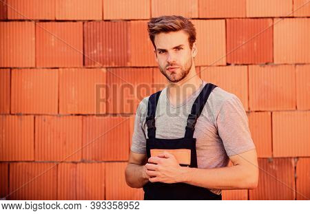 Picky Inspector. Professional Repairman. Turnkey Project. Man Builder In Work Clothes. Building Skil