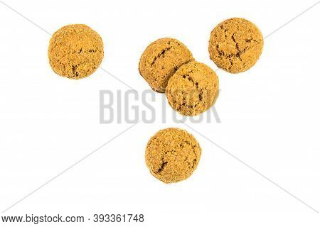 Group Of Five Pepernoten Cookies From Above On White Background For Annual Sinterklaas Holiday Event