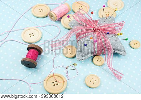 Buttons On The Table With Pins And Ribbons     ,  Sewing Accessories Dressmaker