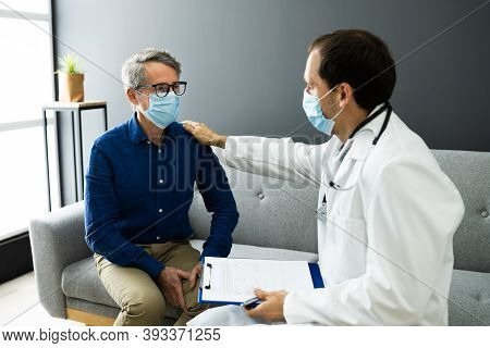 Doctor And Senior Patient Living In Assisted Home Wearing Mask