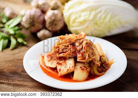 Kimchi Cabbage On White Plate, Homemade Korean Food