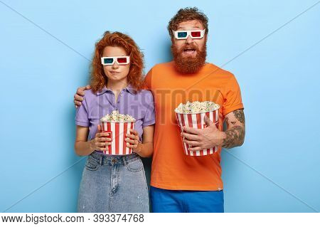 Young Redhead Couple Spend Free Time In 3d Cinema, Eat Popcorn, Wear Special Glasses For Visual Effe
