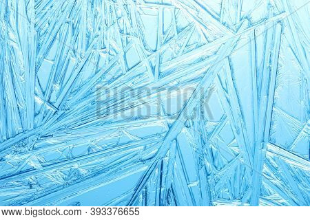 Winter frost covered window with a pattern of ice crystals.