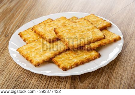 Crunchy Cookies With Sesame In White Plate On Wooden Table