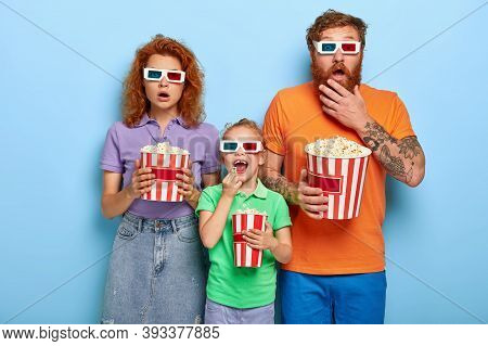 Horrified Parents And Cheerful Daughter Spend Free Time At Cinema, Enjoy Watching Exciting New Film