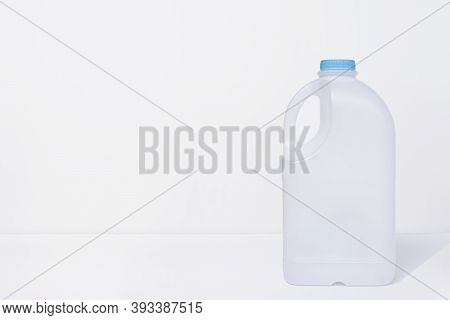 Plastic Milk Gallon Container On White Background With Copy Space