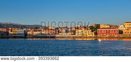 Beautiful View Of Old Venetian Port Of Chania, Crete, Greece, Shop, Hotels, Cafes And Restaurants On