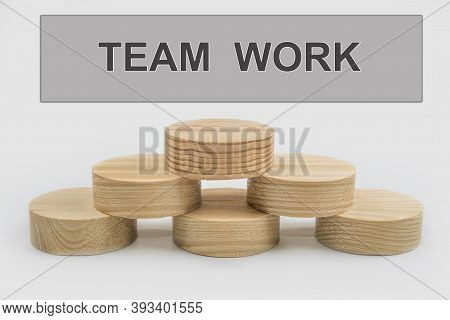 The Team Work Conceptual Sign. Wooden Cutouts