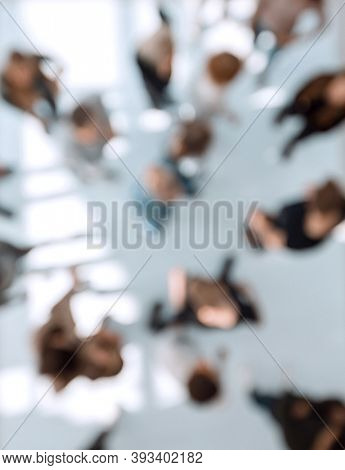 blurred image of a group of diverse people