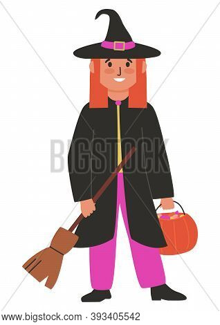 Witch In A Hat And Mantle, With Broom And Pumpkin With Sweets. Cute Little Girl In Halloween Costume