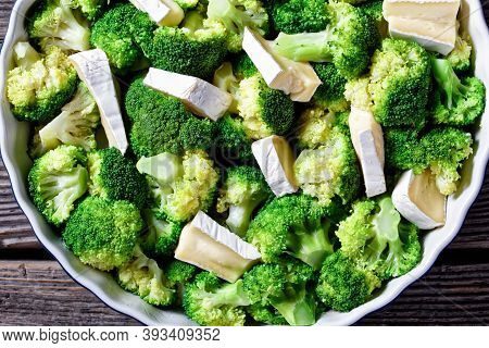 Steamed Broccoli Florets Prepared To Bake With Brie Cheese In A Baking Dish
