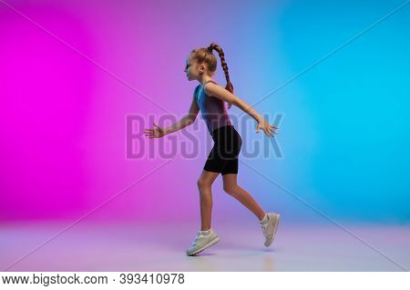 Active. Teenage Girl, Professional Runner, Jogger In Action, Motion Isolated On Gradient Pink-blue B