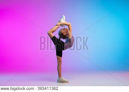 Flexible. Teenage Girl, Professional Runner, Jogger In Action, Motion Isolated On Gradient Pink-blue