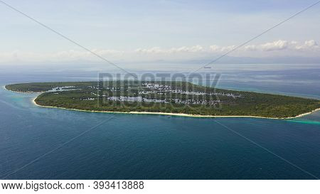 Island With A Sandy Beach And Azure Water Surrounded By A Coral Reef And An Atoll. Great Santa Cruz