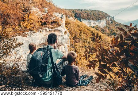 Father With Two Little Boy Traveling In The Mountains. Hiking With Children On A Family Trip. Travel