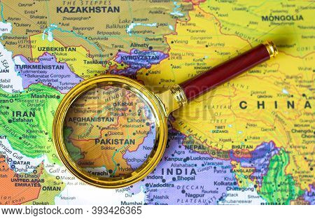 Lviv/ukraine-10 06 2020 : Pakistan, Afghanistan A Map Of Asia In A Defocused Magnifying Glass, The T