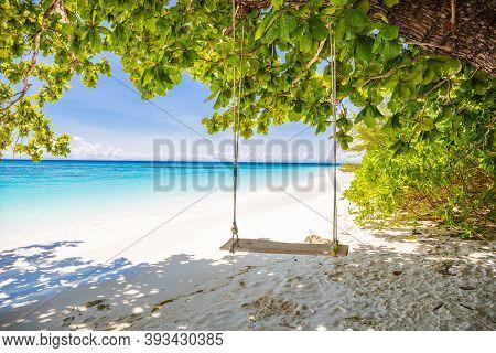 Wooden Swings Under The Trees At Tachai Island Beach Similan Islands Phang Nga, Thailand
