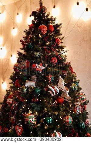 Christmas Balls And Decorations On A Beautiful Christmas Tree. Decorated Christmas Interior. Place F