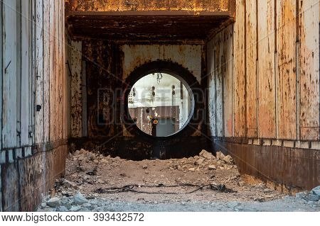 An Unfinished Reactor Block Of A Nuclear Power Plant In Crimea. View Of A Round Hole In A Thick Wall