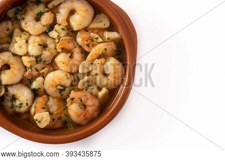 Garlic Prawns In Crock Pot Isolated On White Background. Top View. Copy Space