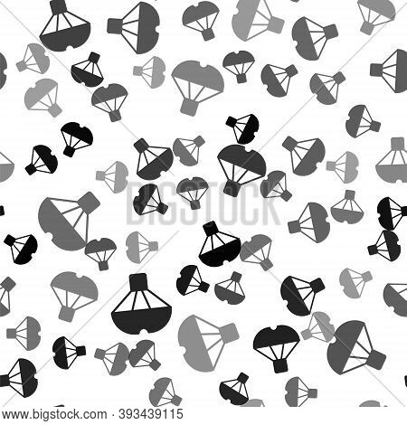 Black Box Flying On Parachute Icon Isolated Seamless Pattern On White Background. Parcel With Parach