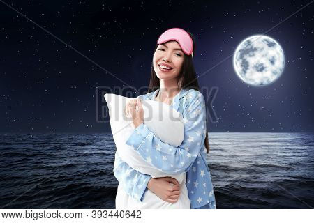 Asian Woman Holding Pillow, Night Starry Sky With Full Moon On Background. Bedtime