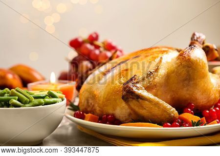 Traditional Thanksgiving Day Feast With Delicious Cooked Turkey And Other Seasonal Dishes Served On