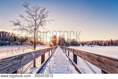 The Snowy Scenery On The Highway Under The Setting Sun In Winter Is Very Beautiful, And The Woods In
