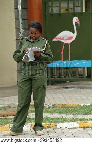 Nakuru, Kenya - August 18, 2010: Woman Park Ranger Takes Account Visitors Near Entrance In The Nakur