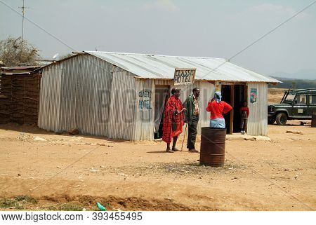 Nairobi Kenya - August 20, 2010: Locals Opposite Cheap Hotel In The Slums Along The Road Near Nairob