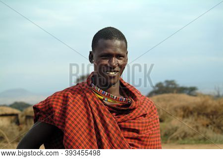 Masai Mara, Kenya - August 23, 2010: An Unidentified African Man In Traditional Dress From Masai Tri