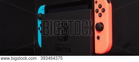 Nintendo Switch video game console developed by Nintendo, released on March 3, 2017 on a black background. Germany, Berlin - June 30, 2019: Nintendo Switch Joy-con controller on a white background