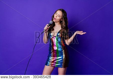 Photo Of Charming Girl Sing Song Hold Microphone Wear Skirt Isolated Over Bright Purple Color Backgr