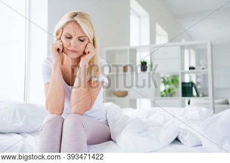Photo Of Displeased Sad Aged Lady Suffer Painful Pms Head Ache Fingers On Temples Wear Pajama White
