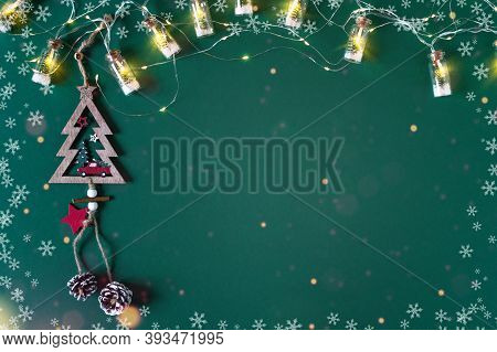 Background With Christmas Lights For Greeting Card. Vintage Holiday Garland With Christmas Tree Insi