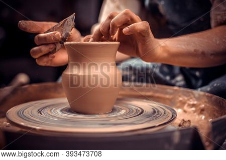 Creating A Jar Or Vase. Master Crock. Making Clay Jug. The Sculptor In The Workshop Makes A Jug Out
