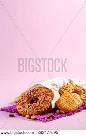 Homemade Shortbread Cookies With Nuts In A Paper Bag On A Linen Cloth. Copy Space, Selective Focus.