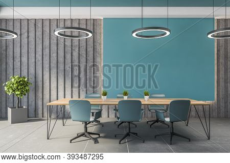 Interior Of Stylish Office Meeting Room With Blue And Gray Walls, Tiled Floor And Long Conference Ta