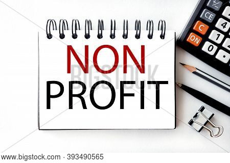 Non Profit, Text On White Notepad Paper On Light Background